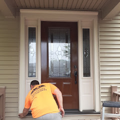 Contractor completing door replacement project in Lancaster, PA