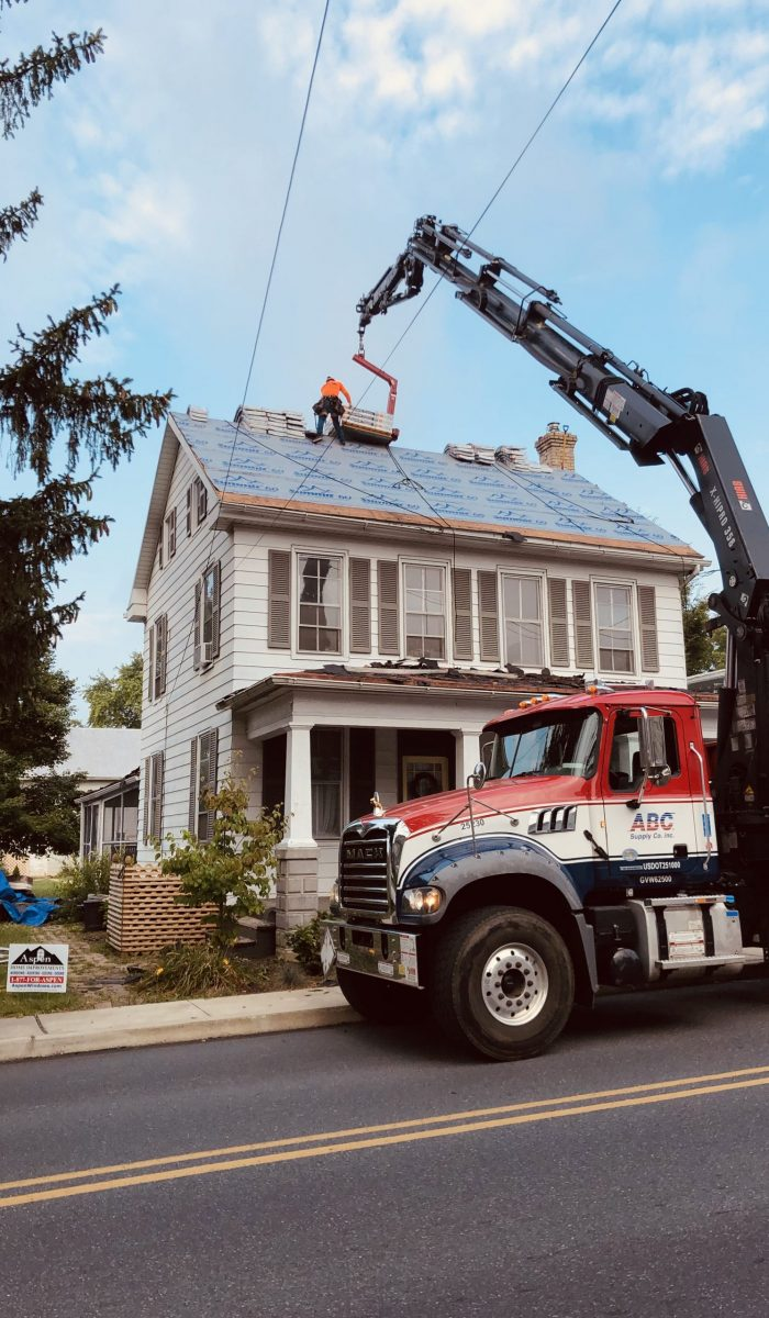 Roof Replacement truck and equipment for installation